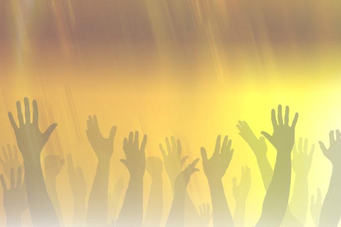 many-hands-raised-to-worship-god